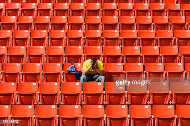 Frustrated Sports Fan in Stadium