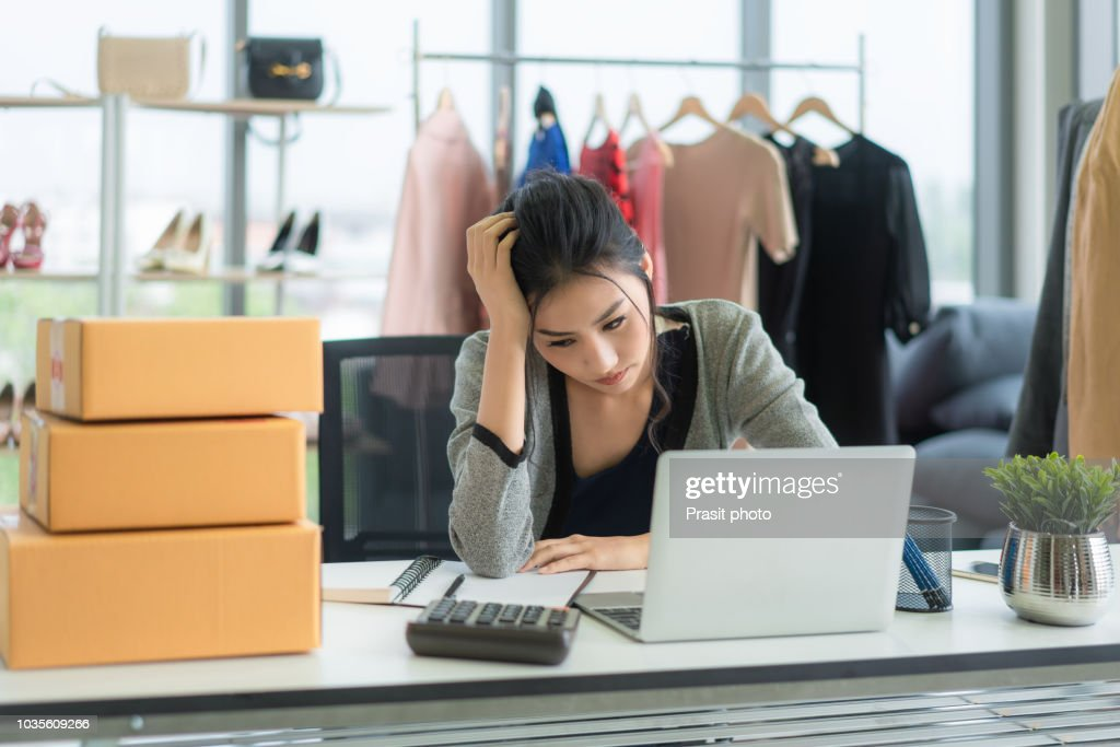 frustrated startup small business owner working at workplace asian