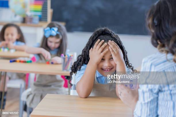 Frustrated student reviews flashcards with teacher