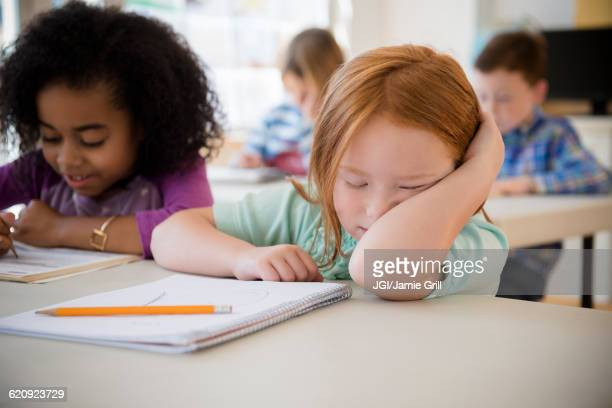 Frustrated student working in classroom