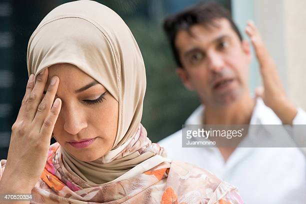 frustrated woman and man in argument - insulting islam stock pictures, royalty-free photos & images