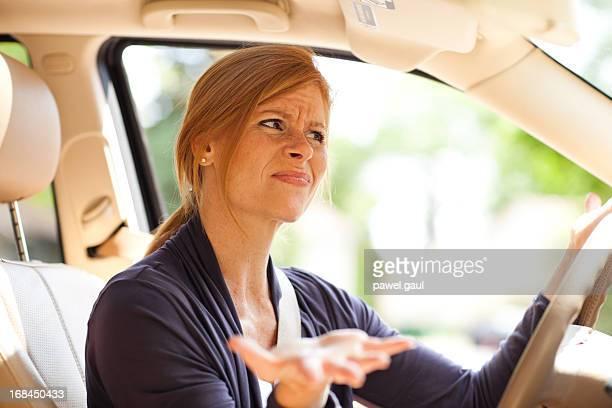 Frustrated woman behind steering wheel