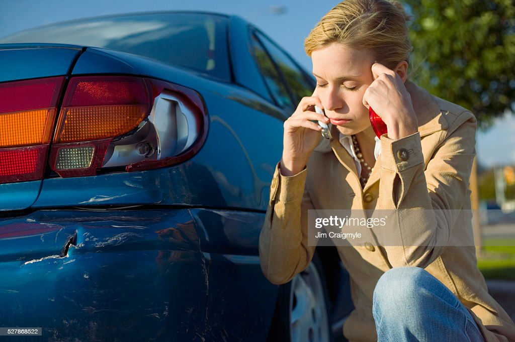 Frustrated Woman Beside Her Broken Taillight : Stock Photo