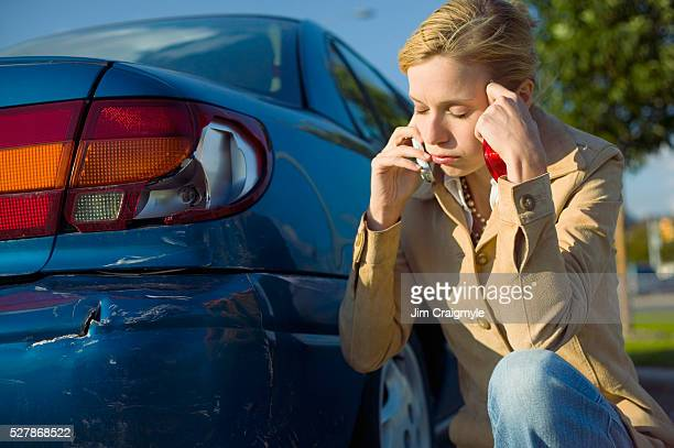 Frustrated Woman Beside Her Broken Taillight