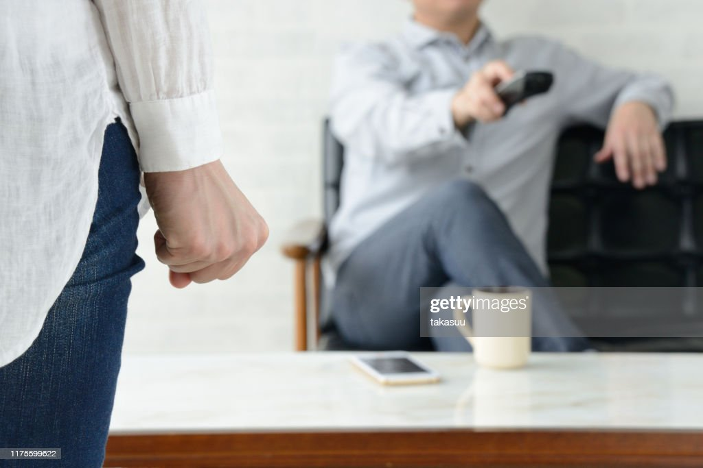 Frustrated woman for man not helping housework : Stock Photo