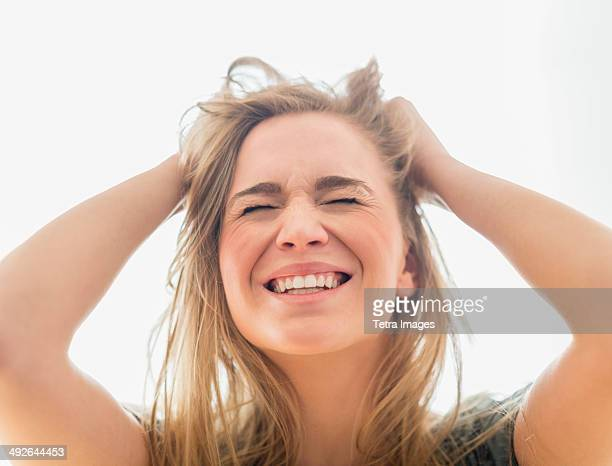 frustrated woman pulling hair - pulling hair stock photos and pictures