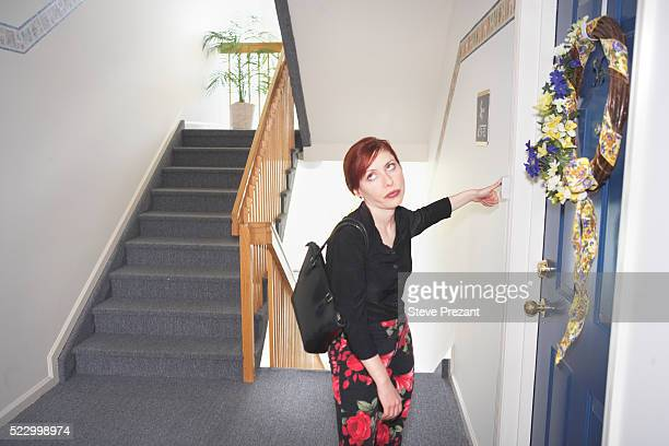 Frustrated Woman Ringing Doorbell