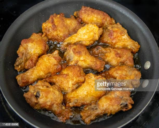frying chicken wings in a pan - mississauga stock pictures, royalty-free photos & images