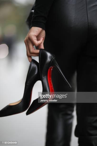 Füsun Lindner holding Christian Louboutin heels on October 13 2019 in Vienna Austria