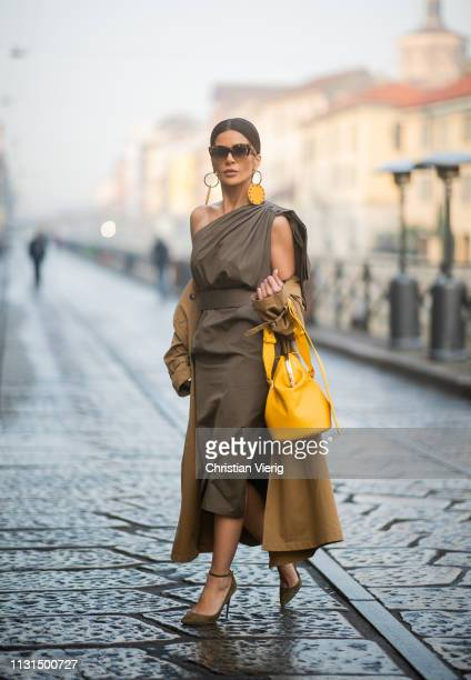 Füsun Lindner is seen wearing khaki dress Max Mara coat Fassbender Jimmy Choo shoes Celine sunglasses earrings Marjana von Berlepsch on Day 2 Milan...