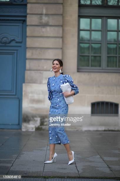 Füsun Lindner wearing a Bottega Veneta bag, Balenciaga heels and a midi blue dress on February 26, 2020 in Paris, France.