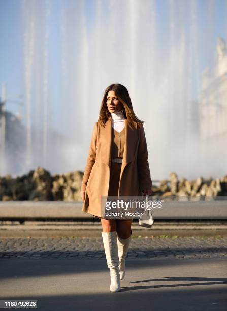 Füsun Lindner wearing a complete Falconeri look and Zara overknees on October 12 2019 in Vienna Austria