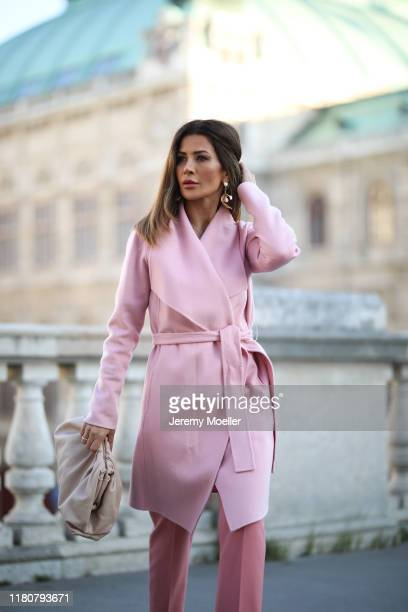 Füsun Lindner wearing a complete Madeleine outfit and a Bottega Veneta bag on October 12, 2019 in Vienna, Austria.