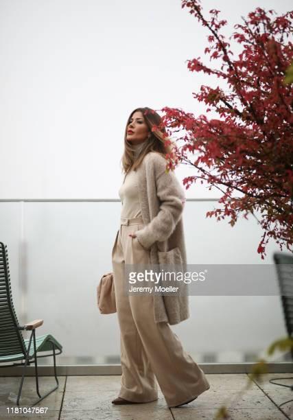 Füsun Lindner wearing a complete Max Mara look and a Bottega Veneta Pouch bag on October 13 2019 in Vienna Austria