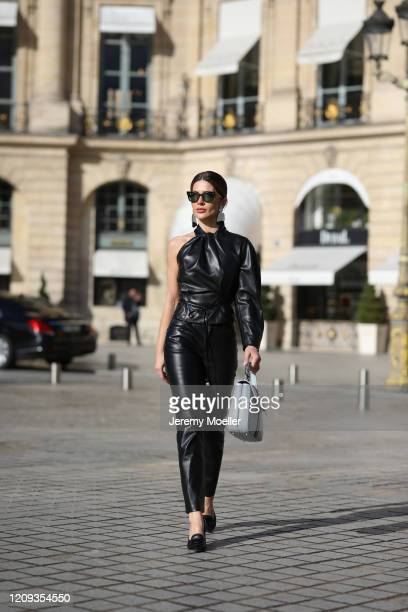 Füsun Lindner wearing Celine shades, Max Mara earrings, Nanushka leather shirt, Mango leather pants, Roger Vivier bag and shoes on February 26, 2020...