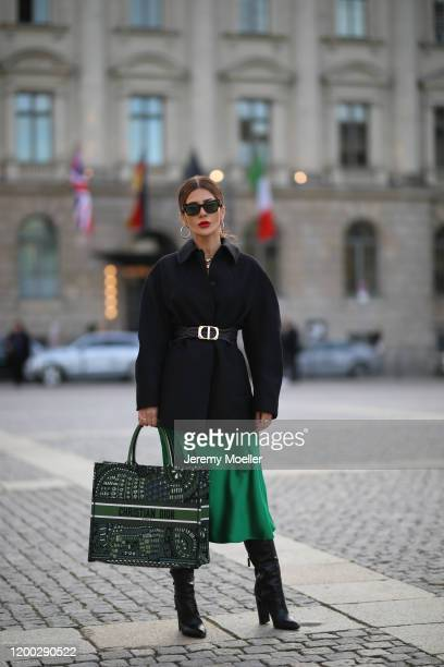 Füsun Lindner wearing Dior bag and belt, Tom Ford boots, Arket skirt, H&M jacket during the Berlin Fashion Week Autumn/Winter 2020 on January 15,...