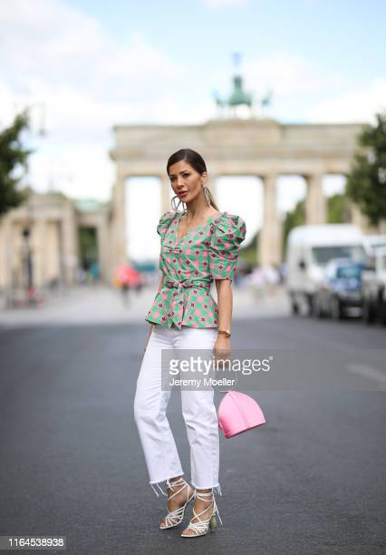 Füsun Lindner wearing Kate Spade blouse Zara jeans Pellegrino Paris bag and Jaquemus heels on July 03 2019 in Berlin Germany