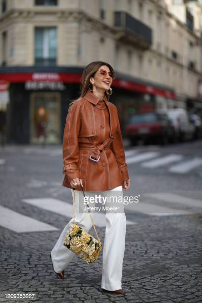 Füsun Lindner wearing Marjana von Berlepsch ring necklace and earring Massimo Dutti jeans Escada bag and leather jacket on February 26 2020 in Paris...