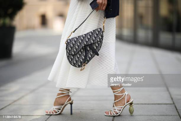 Füsun Lindner wearing Nobi Talai dress and earring, Dior bag and Jacquemus shoes on March 24, 2019 in Munich, Germany.