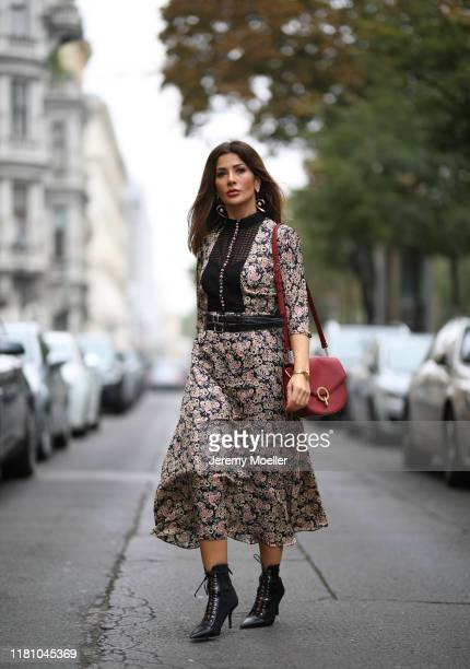 Füsun Lindner wearing Sandro dress and bag and Zara heels on October 13 2019 in Vienna Austria