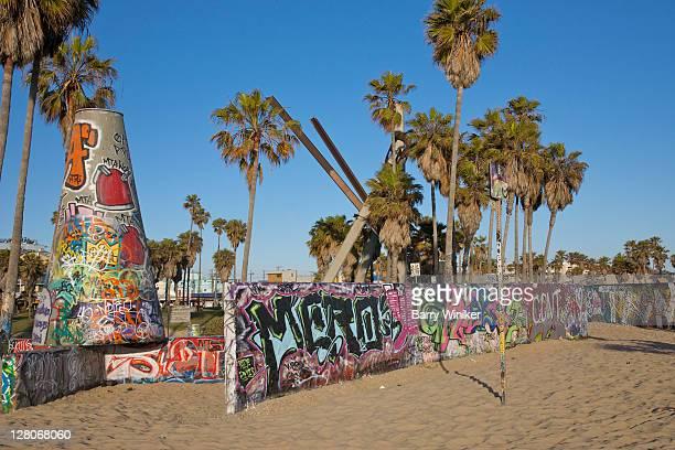 10 ft concrete 'cones' and graffiti walls near Venice Beach Skate Park, Venice Beach, California, USA, May 2010