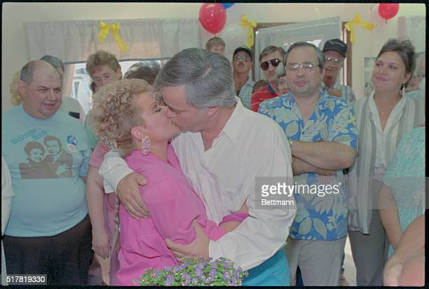 Supporters crowd around as Jim and Tammy Bakker share a kiss following their return to Ft Mill Despite death threats the Bakkers greeted a small...