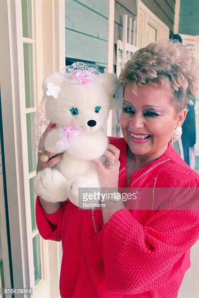 Tammy Bakker shows off a stuffed bear given to her by supporters outside their office in Ft Mill While showing off the toy Bakker quipped it has...