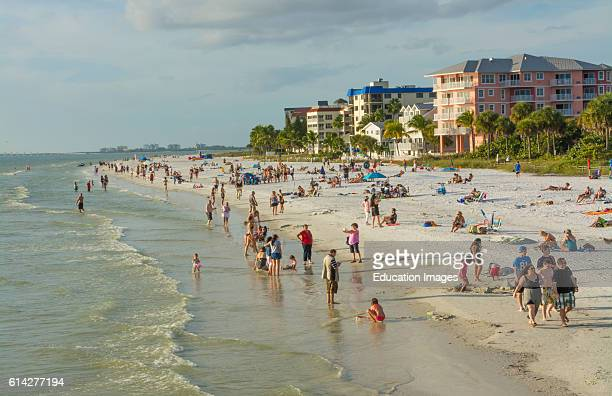 Ft Myers Beach Florida beach at famous pier with tourists sand Gulf of Mexico restaurants crowded water at beach