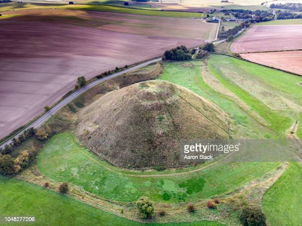 129 ft tall man-made dome rising above farm land shot from air. - hill stock pictures, royalty-free photos & images