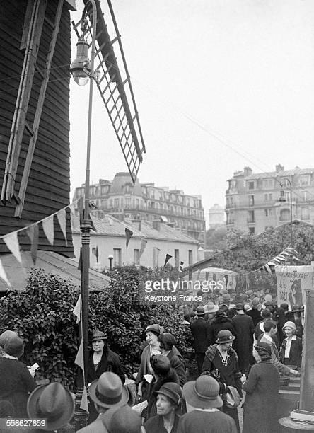 Fête à Montmartre au Moulin de la Galette au profit des 'Poulbots' à Paris France circa 1930