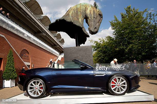Ftype Jaguar beneath the Nic FiddianGreen Equine Sculpture at 'Glorious Goodwood' Goodwood Racecourse 30th July 2014