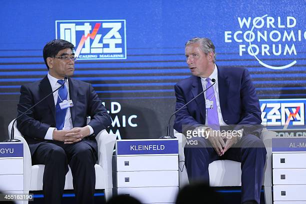 Fu Chengyu Chairman of China Petroleum Chemical Corporation and Klaus Kleinfeld Chairman and Chief Executive Officer of Alcoa attend a meeting titled...