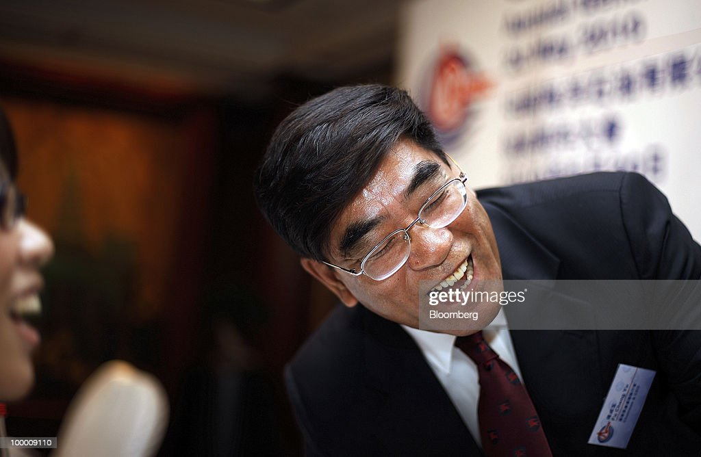 Fu Chengyu, chairman of Cnooc Ltd., laughs during a news conference following the company's annual general meeting in Hong Kong, China, on Thursday, May 20, 2010. Fu declined to say whether the company had bid for a Brazilian asset owned by Statoil ASA. Fu told reporters in Hong Kong he does not wish to comment on 'market rumors.' Photographer: Daniel J. Groshong/Bloomberg via Getty Images