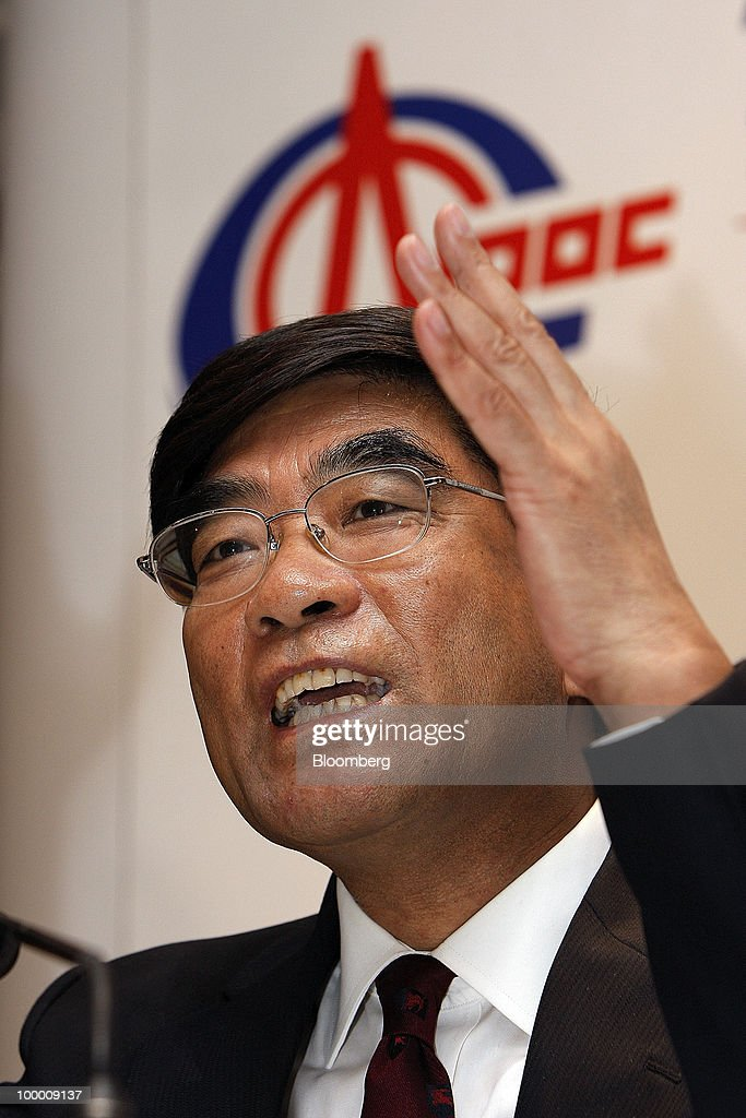 Fu Chengyu, chairman of Cnooc Ltd., speaks at a news conference following the company's annual general meeting in Hong Kong, China, on Thursday, May 20, 2010. Fu declined to say whether the company had bid for a Brazilian asset owned by Statoil ASA. Fu told reporters in Hong Kong he does not wish to comment on 'market rumors.' Photographer: Daniel J. Groshong/Bloomberg via Getty Images