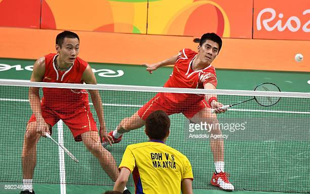 Fu Haifeng and Zhang Nan of China compete against Goh V Shem and Tan Wee Kiong of Malaysia in the Mens Doubles Gold Medal on Day 14 of the 2016 Rio...