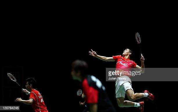 Fu Haifeng goes to play a smash with Cai Yun of China in their doubles match against Vladimir Ivanov and Ivan Sozonov of Russia during day two of the...