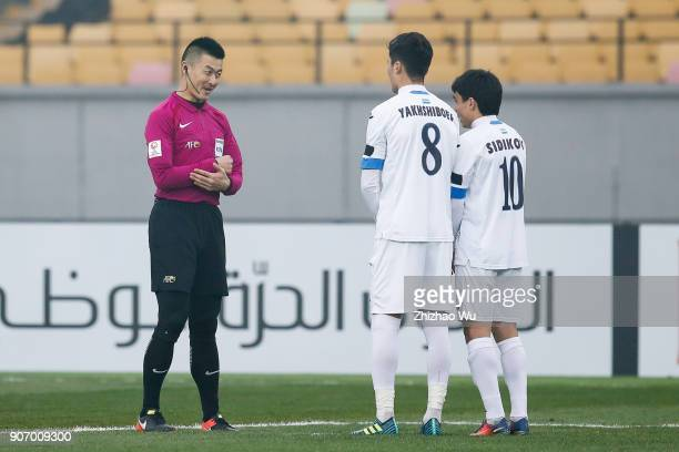 Fu Ming referee of China speaks to players during AFC U23 Championship Quarterfinal between Japan and Uzbekistan at Jiangyin Sports Center on January...