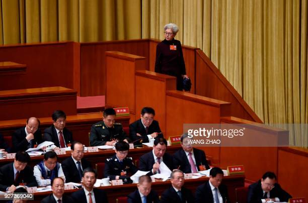 Fu Ying former spokesperson for the fourth session of China's 12th National People's Congress watches during the opening session of the National...