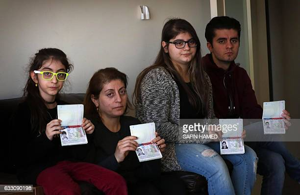Fuad Sharif Suleman and his family show their US immigrant visas in Arbil the capital of the Kurdish autonomous region in northern Iraq on January 30...