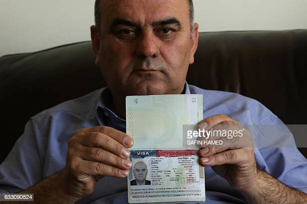 Fuad Sharif Suleman shows his US immigrant visa in Arbil the capital of the Kurdish autonomous region in northern Iraq on January 30 2017 after...