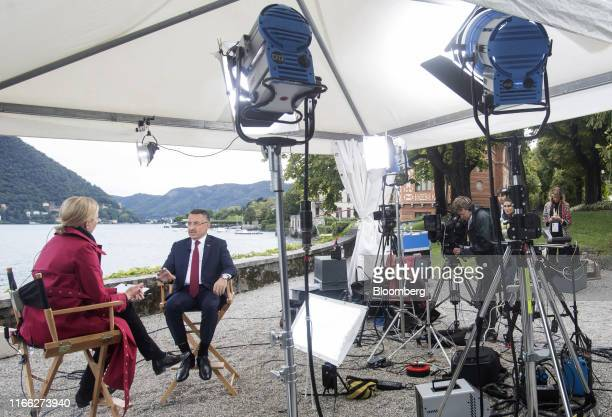 Fuat Oktay, Turkey's vice president, gestures as he speaks during a Bloomberg Television interview on the sidelines at the AmbrosettiForum in...