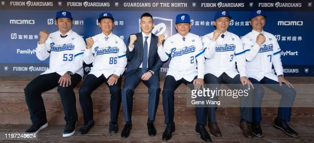 Fubon Guardians' General Manager Chris Tsai and Manager IChung Hong pose with new coaching team KanLin Huang ChienLin Kuo ChienLin Wu and FengPin Hsu...