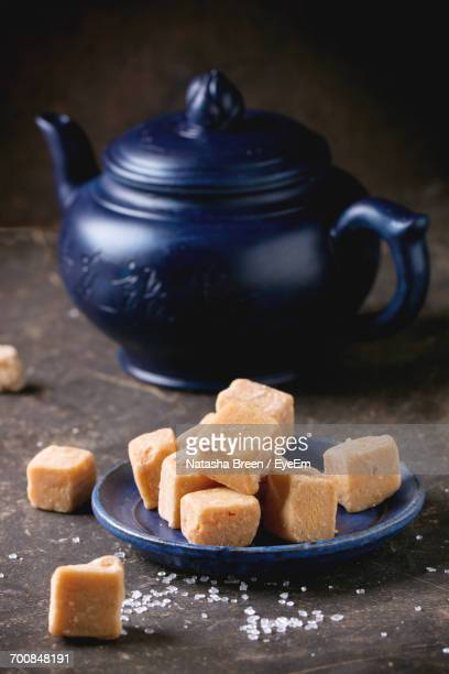 fudge and teapot on table - fudge stock photos and pictures