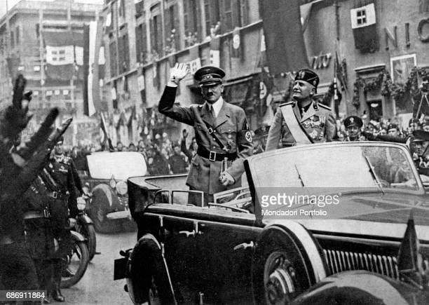 Fuehrer Adolf Hitler and Duce Benito Mussolini on a car saluting the crowd gathering in Corso Vittorio Emanuele Rome 4th May 1938