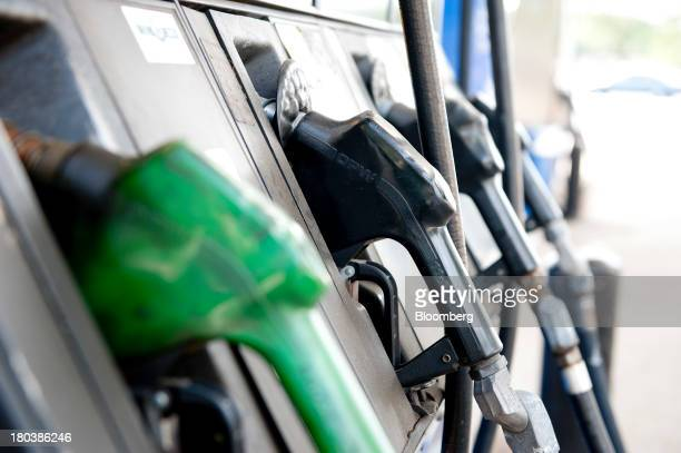 Fuel filler nozzles sit in a gas pump at a gas station in Peoria Illinois US on Wednesday Sept 11 2013 Gasoline climbed in New York trading as crude...