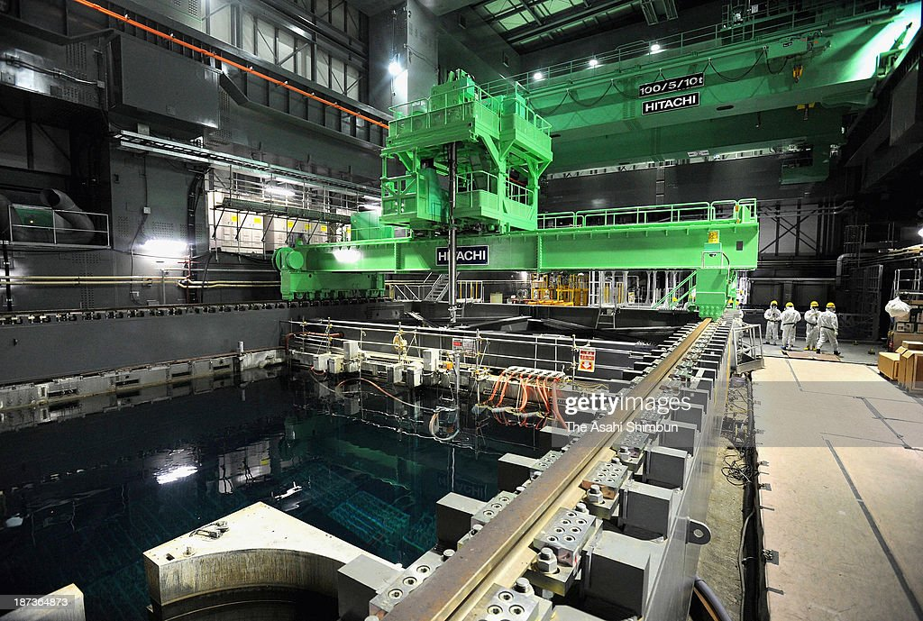A fuel hoist has been installed to remove nuclear fuel from a storage pool in the No. 4 reactor building at the Fukushima Daiichi Nuclear Power Plant on November 6, 2013 in Okuma, Fukushima, Japan. The No. 4 reactor building itself was covered by a canopy to replace the roof that was blown off in an explosion on March 15, 2011. TEPCO plans to transfer the 1,533 nuclear fuel assemblies to a 'storage pool for common use' 100 meters west of the No. 4 reactor. The removal and transfer is expected to be completed at the end of next year.