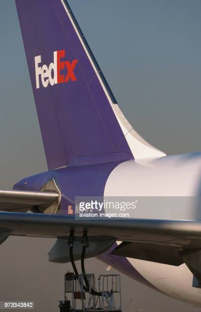 fuel hoses attached to the underside of the wing of a FedEx Airbus A300600 freighter with tailfin behind