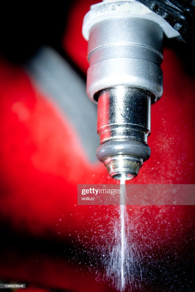 fuel injector in action : Stock Photo