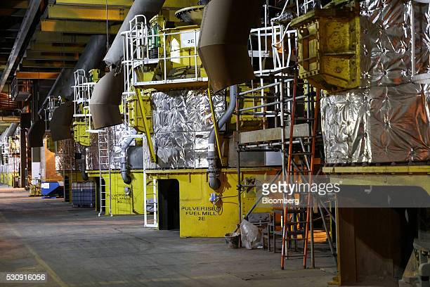 Fuel mill pulverisers operate to produce biomass fuel through Drax Group Plc's power station near Selby UK on Wednesday May 4 2016 Drax Group Plc the...