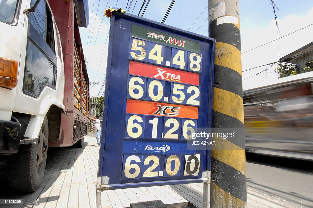 A fuel price board is on display at a gas station in Manila on July